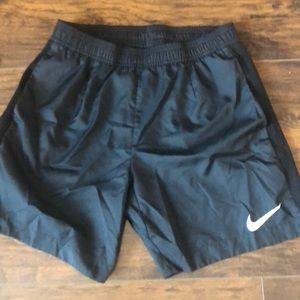 Black Nike tennis shorts